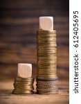 Small photo of stacked coins showing income difference proportion between rich and normal incomes