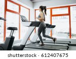 young fit pretty woman doing... | Shutterstock . vector #612407675