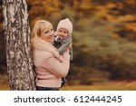 mother with the daughter walk... | Shutterstock . vector #612444245