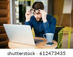business man with glasses... | Shutterstock . vector #612473435