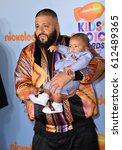 Small photo of LOS ANGELES, CA. March 11, 2017: DJ Khaled & son at the Nickelodeon 2017 Kids' Choice Awards at the USC's Galen Centre, Los Angeles