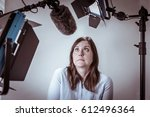 scared and nervous woman under... | Shutterstock . vector #612496364