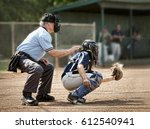 umpire and catcher  just as...   Shutterstock . vector #612540941