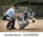 umpire and catcher just as ball ...   Shutterstock . vector #612540941