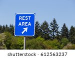 blue rest area sign points to a ... | Shutterstock . vector #612563237