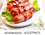 pigs in blankets   sausages... | Shutterstock . vector #612579671