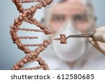 scientist is replacing part of... | Shutterstock . vector #612580685