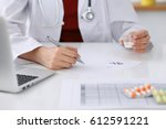Small photo of Female medicine doctor fills up prescription form to patient closeup. Panacea and life save, prescribe treatment, legal drug store, contraception concept