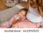 little girl listening baby in... | Shutterstock . vector #612593525