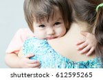 mother hugging child  physical... | Shutterstock . vector #612595265