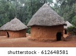 Mud huts in african village