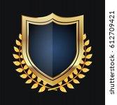 golden shield with laurel... | Shutterstock . vector #612709421