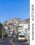 Small photo of VIDIGAL FAVELA, RIO DE JANEIRO, BRAZIL - JANUARY 11, 2017: vidigal favela housing on bright summer day, pacified slum area with developed touristic attractions