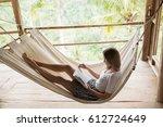 young woman relaxing in hammock ... | Shutterstock . vector #612724649