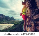 young woman rock climber... | Shutterstock . vector #612745007