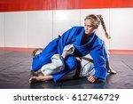 a young woman in a kimono makes ... | Shutterstock . vector #612746729