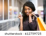 african american woman shopping | Shutterstock . vector #612759725