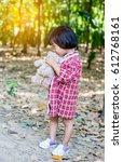 girl embracing teddy bear | Shutterstock . vector #612768161