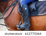 the rider sits on a brown... | Shutterstock . vector #612775364