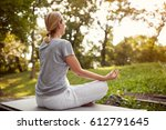 female in lotus pose in green... | Shutterstock . vector #612791645