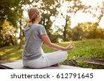 female in lotus pose in green... | Shutterstock . vector #612791645