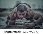 closeup of strong athletic man... | Shutterstock . vector #612792377