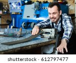 young diligent friendly smiling ... | Shutterstock . vector #612797477