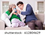 sick wife and husband at home | Shutterstock . vector #612804629