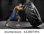 muscular man working out in gym ... | Shutterstock . vector #612807491