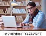 young book writer writing in...   Shutterstock . vector #612814349