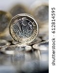 Small photo of closeup of new pound coin introduced in Britain in 2017, front, with mirror reflection