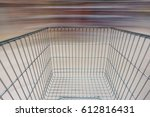 supermarket aisle with empty... | Shutterstock . vector #612816431