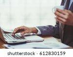 businesswoman using calculator... | Shutterstock . vector #612830159