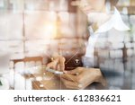 young businesswoman hand with... | Shutterstock . vector #612836621