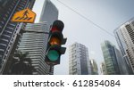 green traffic light in the city ... | Shutterstock . vector #612854084
