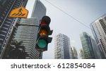 green traffic light in the city ... | Shutterstock . vector #612854084