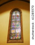 Stained-glass window in Catholic temple. Rome. Italy - stock photo
