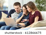 three angry friends watching... | Shutterstock . vector #612866675