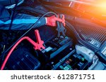 accumulator charging. hands and ... | Shutterstock . vector #612871751