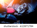 cleaning disc brake on car  in... | Shutterstock . vector #612871784