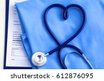 medical stethoscope twisted in... | Shutterstock . vector #612876095