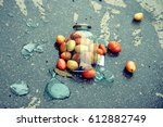 A Broken Glass Jar With Tomatoes
