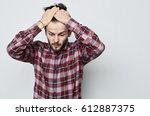 young caucasian man with beard... | Shutterstock . vector #612887375