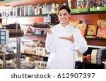seller demonstrating delicious... | Shutterstock . vector #612907397
