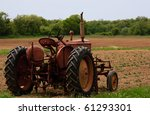 Old Red Rusty Farm Tractor At...