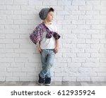 cute stylish boy near light... | Shutterstock . vector #612935924