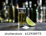 golden tequila shot with juicy... | Shutterstock . vector #612938975