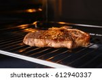 tasty grilled steak in oven | Shutterstock . vector #612940337