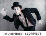 pantomime theater artist posing ... | Shutterstock . vector #612954875