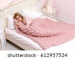 young woman sleeping in bed... | Shutterstock . vector #612957524